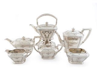 An American Silver Six-Piece Tea and Coffee Service Height of kettle on stand 10 7/8 x length 9 x width 5 inches.