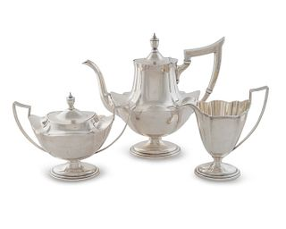An American Silver Three-Piece Tea Service Height of teapot 10 x length 10 3/4 x width 5 inches.