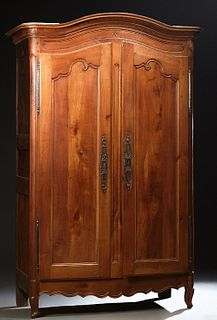 French Provincial Inlaid Carved Cherry Armoire, early 19th c., the stepped arched ogee crown over arched double doors with long iron...