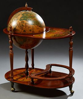 French Carved Beech World Globe Bar, 20th c., with antique map decoration, the interior fitted for a bottle and glasses, the oval to...
