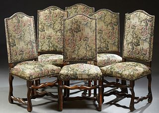 Set of Six Louis XIII Style Carved Beech Dining Chairs, 19th c., the arched crestrail above a canted back and trapezoidal seat, on s...