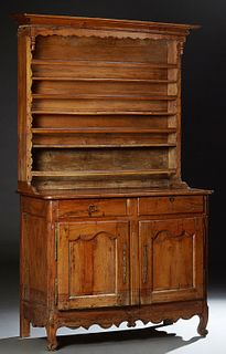 French Louis XV Style Carved Oak Vaisselier, 19th c., the stepped cavetto crown above three plate racks, on a plank top rounded corn...