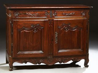 French Provincial Louis XV Style Carved Pine Sideboard, early 19th c., the lifting rounded corner and edge top over a storage area a...
