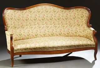 French Louis Philippe Carved Cherry Settee, 19th c., the arched curved serpentine back to upholstered arms on a bowed seat, to squar...