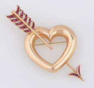 """14K Yellow Gold and Ruby Heart Brooch, 20th c., the large heart pierced by an arrow with a ruby mounted """"feather"""" fletching and arro..."""