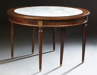French Louis XVI Style Ormolu Mounted Circular Marble and Mahogany Dining Table, 20th c., the inset figured white marble top opening...