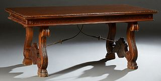 French Carved Walnut Renaissance Style Drawleaf Dining Table, early 20th c., the stepped carved edge top on large scrolled trestle b...
