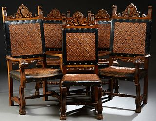 Set of Six Renaissance Style Carved Walnut Dining Chairs, 20th c., the arched shield carved crest over an embossed leather back with...