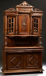 French Carved Walnut Henri II Style Carved Oak Buffet a Deux Corps, c.1880, the pierced crest over a stepped crown above a setback c...