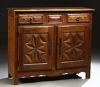 French Provincial Louis XV Style Carved Oak Sideboard, 19th c., the rounded edge three board top over two frieze drawers and two cup...