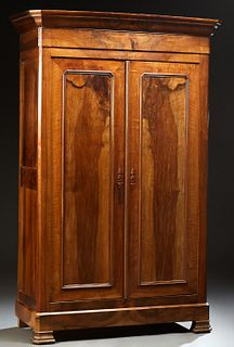 French Louis Philippe Carved Walnut Armoire, 19th c., the stepped sloping canted corner over double paneled doors, on a plinth base...