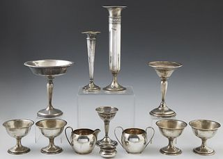 Twelve Sterling Pieces, consisting of a creamer and sugar by Gorham; 4 sorbet cups; a wine glass holder; creamer and sugar; salt; li...