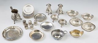 Thirty-Eight Sterling Pieces, consisting of 15 butter pats; an English salt and pepper shaker; 8 reticulated nut dishes; an oval bea...