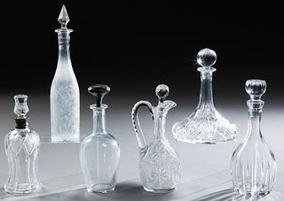 "Group of Six Crystal Decanters and Stoppers, early 20th c., consisting of a Waterford ""Marquis"" example; a cut crystal handled examp..."
