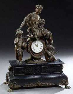 French Patinated Spelter and Black Marble Mantel Clock, 19th c., with a figure of a classical female sculptress atop a drum clock, f...