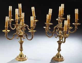 Pair of French Bronze Seven Light Candelabra, early 20th c., with a central raised candle arm flanked by six relief curved candle ar...