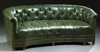 English Style Green Leather Chesterfield Sofa, 20th c., the curved tufted leather back and arms over a tufted concave seat, with iro...