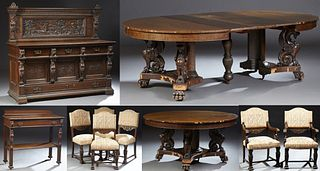 Carved Oak Nine Piece Dining Room Suite, in the style of Horner, consisting of a server, a figural carved sideboard, 6 (4 + 2) uphol...