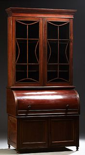 English Carved Mahogany Secretary Bookcase, 19th c., the stepped crown over double mullioned glazed doors, above a cylinder desk, op...