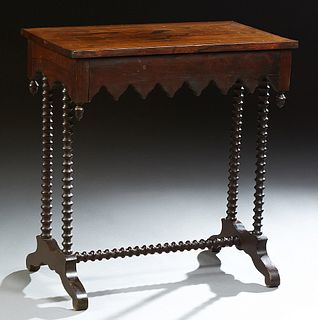 American Carved Rosewood Gothic Revival Side Table, 19th c., the rectangular top over a drawer with a Gothic serpentine skirt, on bo...
