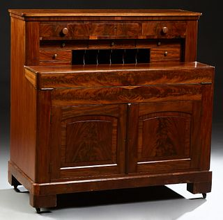 American Carved Mahogany Fall Front Desk, late 19th c., the rectangular top over three frieze drawers above cubbyholes and seven fit...