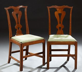 Pair of English Carved Mahogany Chippendale Style Side Chairs, early 20th c., the serpentine backs with pierced vertical splats, to...