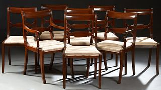 Set of Eight (6 +2) American Carved Mahogany Dining Chairs, late 19th c., the scrolled curved crest rail over a pierced horizontal s...