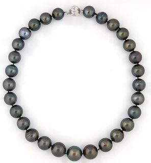 Graduated Strand of 29 Dark Grey Tahitian Cultured Pearls, ranging from 13-16 mm, with a 14K white gold ball clasp, L.- 17 in., with...