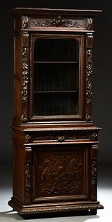 French Provincial Henri II Style Carved Oak Bookcase Cupboard, c. 1880, the stepped ogee crown over a glazed door flanked by relief...