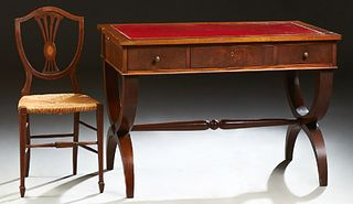 English Style Carved Mahogany Desk, early 20th c., the gilt tooled red leather inset top over three frieze drawers, with pullout lik...