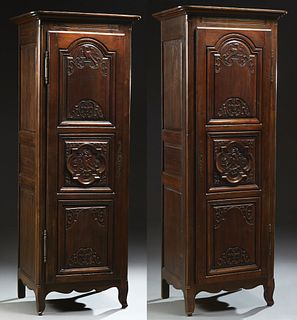 Matched Pair of French Provincial Louis XV Style Carved Walnut Bonnetieres, late 19th c., the stepped rounded corner crown over trip...
