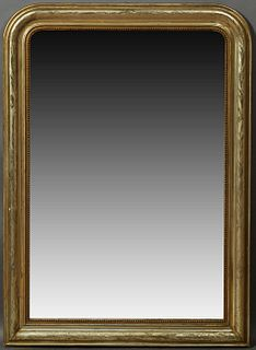 French Louis Philippe Gilt Pine Overmantel Mirror, 19th c., the wide arched frame with incised leaf and floral decoration, around a...