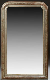 French Louis Philippe Silver Gilt Overmantel Mirror, 19th c., the arched top wide frame with incised floral and leaf decoration, aro...