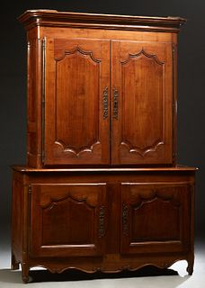 French Provincial Louis XV Style Carved Cherry Buffet a Deux Corps, 19th c., the stepped rounded corner crown over fielded panel dou...