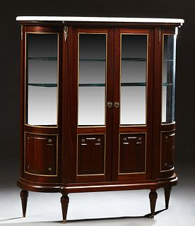 French Louis XVI Style Carved Mahogany Marble Top Ormolu Mounted Vitrine, 20th c., the ogee edge figured white marble over double do...