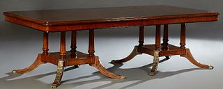 Empire Style Inlaid Walnut Dining Table, 20th c., the stepped rounded corner top on two gilt acanthus carved reeded column pedestals...
