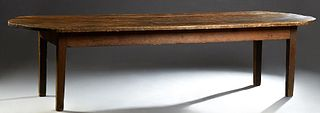 French Carved Pine Farmhouse Table, 19th c., the rounded end top over a wide skirt, on tapered square legs, H.- 28 3/4 in., W.- 120...