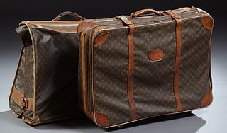 """Two Vintage Louis Vuitton Suitcases, with the """"LV"""" logo, one a folding hanging garment bag; the second a large suitcase on wheels, W..."""