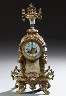 French Louis XVI Style Bronze and Porcelain Mantel Clock, 19th c., the surmount with a tapered floral painted Sevres style porcelain...