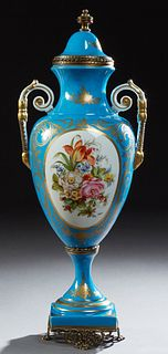 French Sevres Style Brass Mounted Covered Porcelain Handled Vase, 20th c., in Bleu d'Celeste with gilt decoration, and a painted flo...