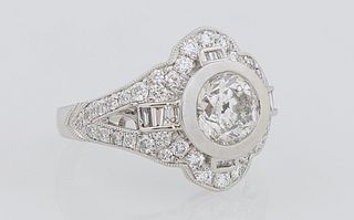 Lady's Platinum Dinner Ring, with a central 1.5 carat round diamond, flanked by pierced diamond mounted lugs