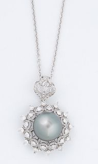 Lady's 18K White Gold Pendant, with a 12