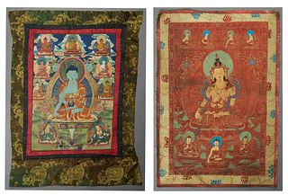 Two Tibetan Silk Thangkas, 19th c., oil on silk of a central Buddha surrounded by clouds and other deities, one with a black border,...