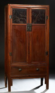 Chinese Tall Carved Elm Cabinet, 19th c., Qing Dynasty, the rectangular top over double two panel doors, the upper panel incised car...