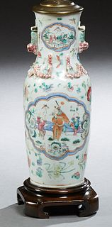 Chinese Porcelain Baluster Vase, 19th c., the everted neck with Foo dog mounted handles and small reserves of children over relief d...
