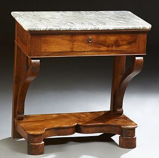 French Louis Philippe Carved Walnut Marble Top Console Table, 19th c., the highly figured rounded edge and corner top over a frieze...
