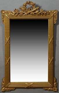 French Louis XVI Style Gilt and Gesso Overmantle Mirror, late 19th c., with a pierced wreath, quiver and torch crest flanked by leav...
