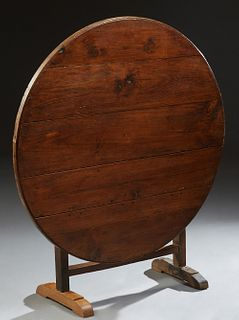 French Provincial Carved Pine Wine Tasting Table, 19th c., Bordeaux, the tilting circular top on a gate leg trestle form base, Close...