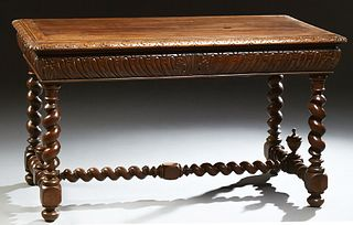 French Louis XIII Style Carved Walnut Writing Table, 19th c., the carved edge top over a sloping indented carved skirt, on rope twis...