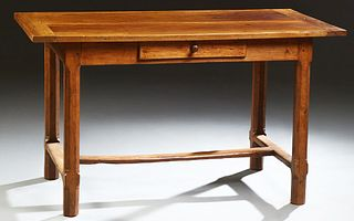 French Provincial Carved Cherry and Walnut Writing Table, 19th c., the two board top over a center frieze drawer, on octagonal legs,...